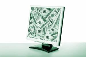 a computer screen showing US Dollar bills